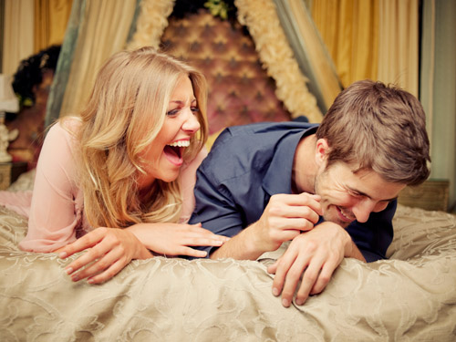 ghk-couple-laughing-bed-lgn
